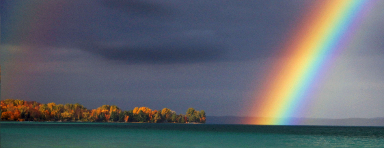 Rainbow over Torch Lake by John Peal